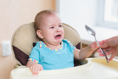 Nine baby cries before feeding at home. Baby hungry and need to be fed Stock Photography