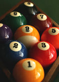 Nine Ball. A set of billiard balls racked and ready for a game of nine ball.  Focus on the nine ball Stock Image