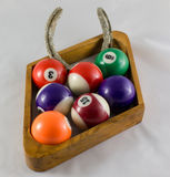 Nine Ball  With Luck Substitute. Nine Ball Pool Rack With Horseshoe in rack in place of some balls Royalty Free Stock Photos