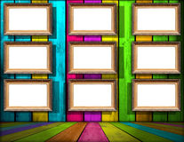 Nine Blank Frames in Multicolored Wooden Room Stock Images