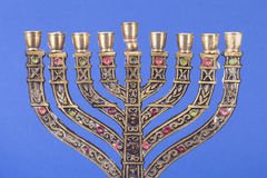 Nine-branched menorah isolated on blue background Stock Photos