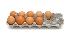 Nine brown eggs in box isolated Royalty Free Stock Photos