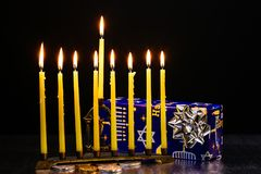 Nine burning candles on blurred background. Hanukkah concept. Hanukkah menorah with candles lit Nine burning candles on blurred background. Hanukkah concept Royalty Free Stock Photo