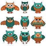 Nine cartoon funny owls Royalty Free Stock Photo