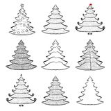 Nine Christmas trees set black on white Stock Photo