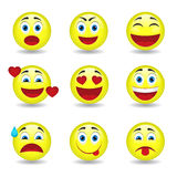 Nine circular emoticons. Nine circular and yellow emoticons: surprise, passionate, worried, happy, smiling, scared Stock Images