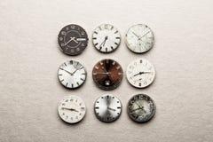 Nine clock dials Stock Photos