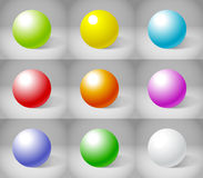 Nine color plaster spheres Stock Images