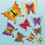 Nine colorful bright butterflies. On a blue background Royalty Free Stock Image