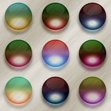 Nine colorful glass balls on brushed metal background Stock Photo