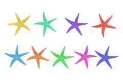 Nine colorful starfish on a white background. Nine starfish in different colors, pink, green, blue, turquoise, purple, beige, red and yellow on a white Royalty Free Stock Photography