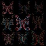 Nine contour luminous butterflies. On a black background. Elegant Stock Photos