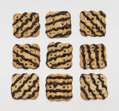 Nine cookies covered with chocolate icing Royalty Free Stock Photo