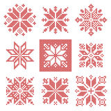 Nine cross stitch snowflakes pattern, Scandinavian style. Set of nine cross-stitch snowflakes pattern, Scandinavian style. Geometric redwork ornament for Stock Photo