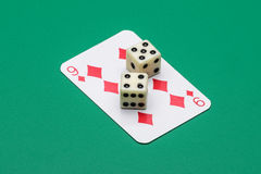 Nine of diamonds and two dice with the same number drawn Royalty Free Stock Photo