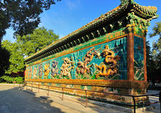 Nine-Dragon Screen in Beihai Park. Built in 1756, the Nine-Dragon Screen is about 27 meters (about 88.6 feet) long, 6.65 meters (about 21.8 feet) high and 1.42 Stock Photography