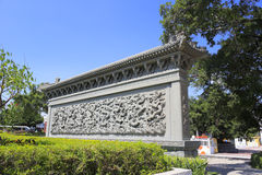 Nine dragon wall. At amoy city, china.  belongs to a screen wall. it is han building outside the main entrance, is on the door to make wall barrier royalty free stock photos