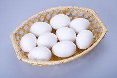 Nine eggs in a basket Stock Images