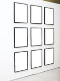 Nine empty frames on white wall exhibition. In Museum stock photos