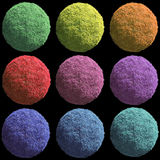 Nine fluffy buttons on black. 3D fluffy balls of various colors (green, yellow, orange, red, magenta, lilac, violet, blue and light blue) on black background Royalty Free Stock Photo