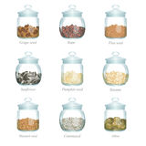 Nine glass jars with oil seeds in them Royalty Free Stock Photo