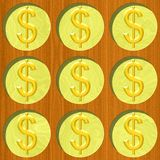 Nine gold dollar coins on wooden desk pattern texture Royalty Free Stock Photo