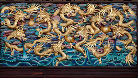 Nine Golden Dragons Playing with Balls. Wooden. Stock Photography