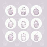 Nine hand drawn outline cupcakes. Royalty Free Stock Photography