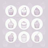 Nine hand drawn outline cupcakes. Vector hand drawn illustration royalty free illustration