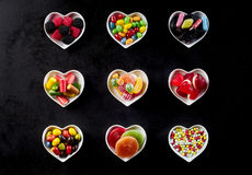 Nine heart shaped white bowls in rows of three stock image