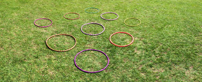Nine 9  hula hoops on a green grass Royalty Free Stock Photography