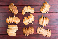Nine loaves of bread sliced in staggered formation Stock Image