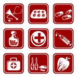 Nine medical symbols. The stylized medical symbols: a stethoscope, pills in different packing, a syringe, ampules and the first-aid set Royalty Free Stock Image