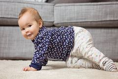Nine months old baby girl on the floor Royalty Free Stock Images