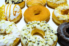 Nine nice donuts. A selection of donuts with different toppings Stock Photography