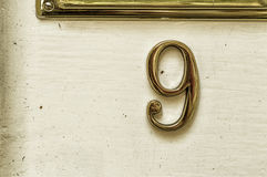 Nine. Number nine one in a white door Stock Images