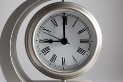 Nine O'Clock. Metal clock with white face showing nine o'clock Stock Photography