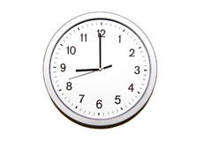 Nine o`clock. Wall clock isolated on white and signing the nine o clock hour - part of 12 hours series Royalty Free Stock Images
