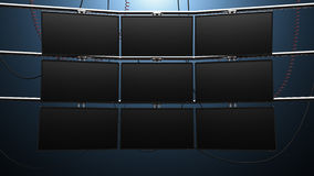 Nine Panel Video Monitor Wall. A futuristic nine panel video wall with blank screens and cords mounted on pipes Royalty Free Stock Image