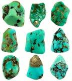 Nine polished rough turquoise stones isolated on white background. Nine pieces polished rough turquoise stones isolated on white background. Differents shapes Stock Image