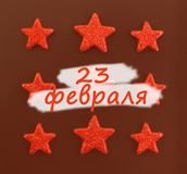 Nine red stars on black background. Flat lay. View from above. Day of the defender of Fatherland. The day of Soviet and Russian. Armies. Russian text stock images