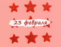 Nine red stars on pink background. Flat lay. View from above. Day of the defender of Fatherland. The day of Soviet and Russian. Armies. Russian text royalty free stock photography