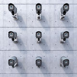 Nine security cameras. On a concrete wall Royalty Free Stock Photos