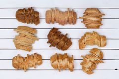 Nine sliced loaves of various breads Royalty Free Stock Photo
