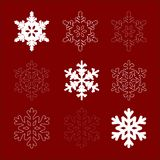 Nine snowflakes. Set of snowflakes on a red background Royalty Free Stock Photos