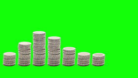 Nine stacks of coins rise, fall and rise again - Stop Motion - Chroma Key. stock footage