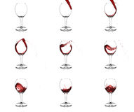 Nine stages of pouring red wine into glass. Nine stages of pouring red wine into wine glasses with beautiful curls  and splashes on white background Stock Images