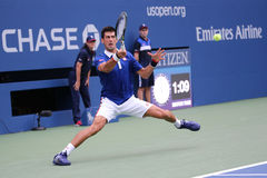 Nine times Grand Slam champion Novak  Djokovic in action during first round match at  US Open 2015 Stock Image