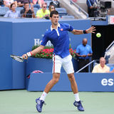 Nine times Grand Slam champion Novak  Djokovic in action during first round match at  US Open 2015 Royalty Free Stock Photo
