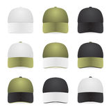 Nine two-color caps with white, khaki and black colors. Isolated on white Royalty Free Stock Photos